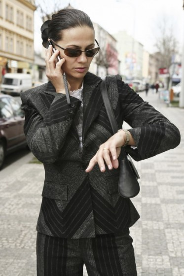 Businesswoman talking on the phone in the street