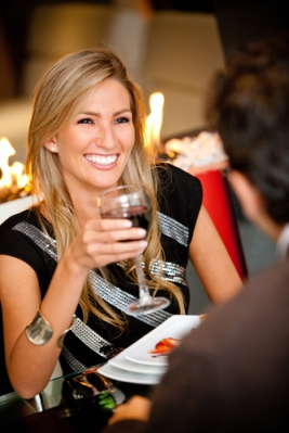 woman_in_a_romantic_dinner_toasting_with_wine