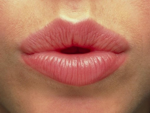 close-up-of-the-pink-lips-of-a-woman-front-view-phil-jude
